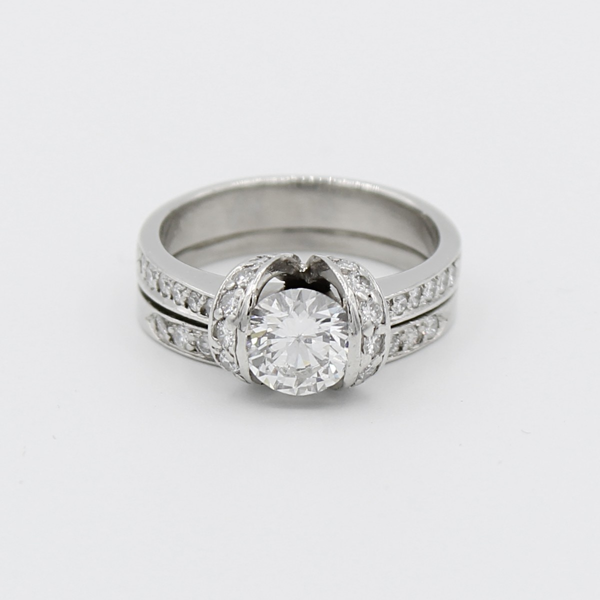 PLATINUM ROUND BRILLIANT DIAMOND RING 1.09 CARATS WITH MATCHING BAND