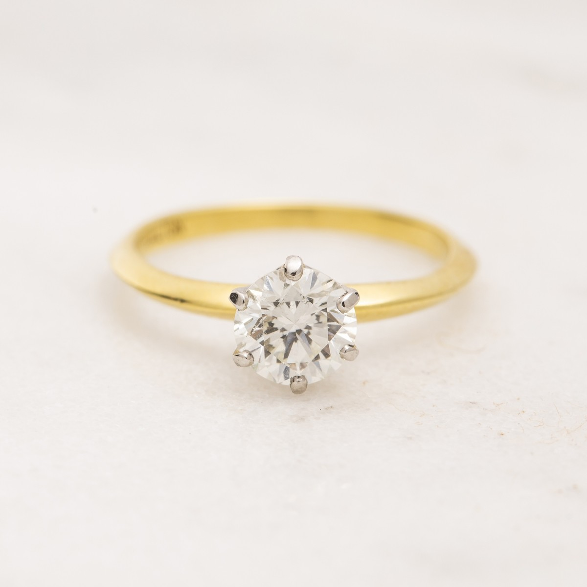 VINTAGE PLATINUM AND 18K YELLOW GOLD DIAMOND SOLITAIRE RING