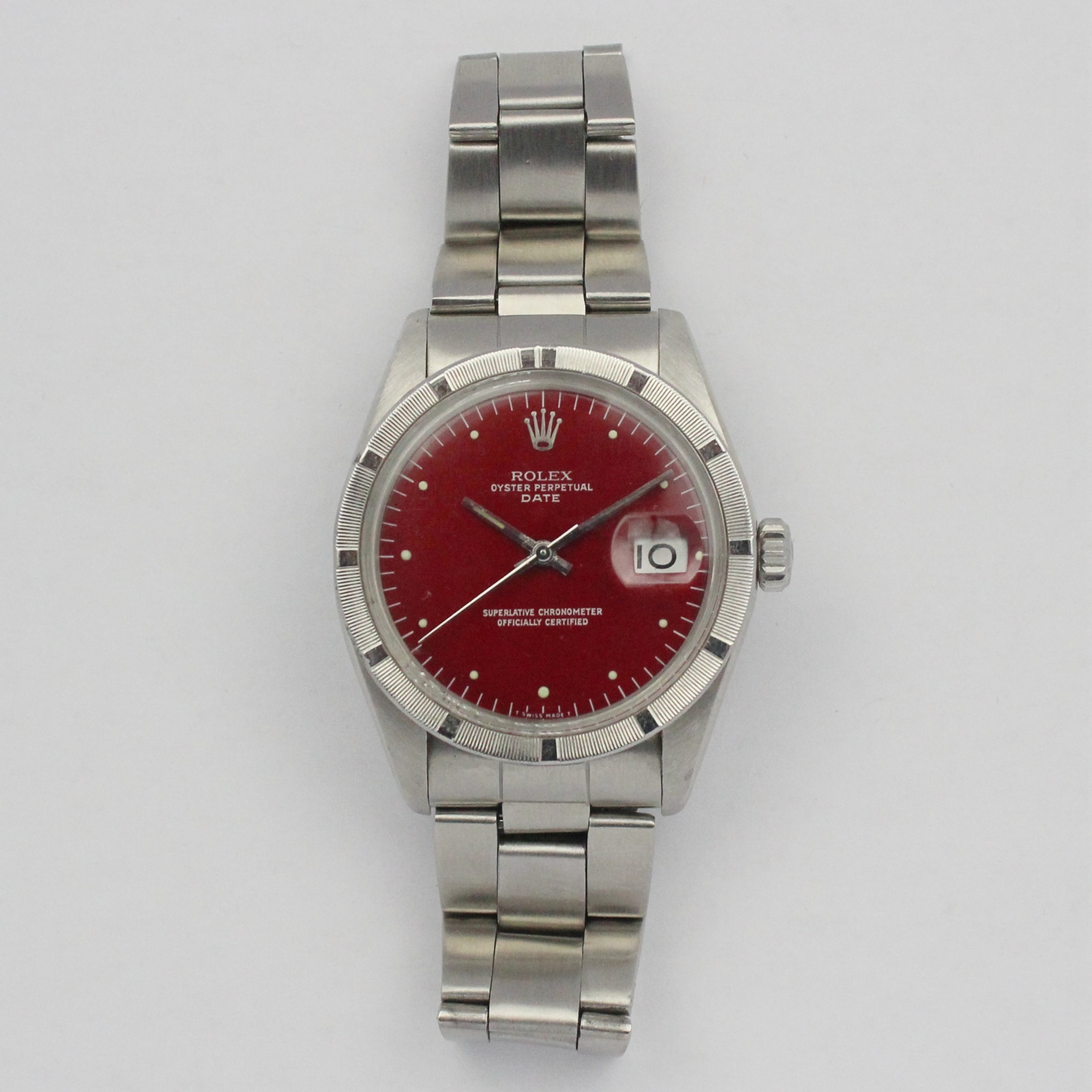 CIRCA 1970S STAINLESS STEEL 34MM ROLEX WITH RED DIAL